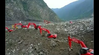 Download Three survivors and 15 dead in massive China landslide Video
