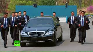 Download Men in Black: Kim's bodyguards run by his limo during summit Video