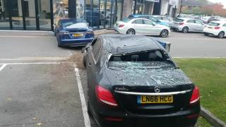 Download Tesla crashes into Mercedes-Benz dealership Video