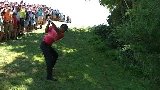 Download Tiger Woods' spectacular recovery shot on No. 12 at Quicken Loans Video