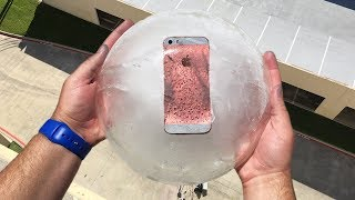 Download Can iPhone SE Survive 100 FT Drop Test Frozen in Ice Block? Video