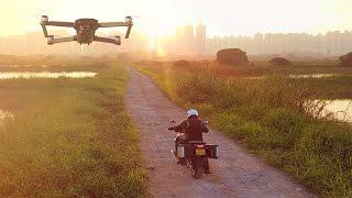 Download DJI Mavic Pro Visual Tracking a Motorcycle - HeliPal Video