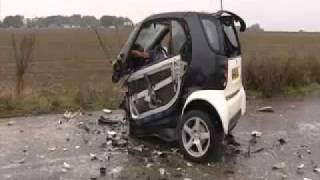 Download smart car crash. with 70 miles against a concrete wall Video
