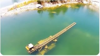 Download Phantom Drone Flies Over Flooded Quarry | Finds Buried Treasure Video