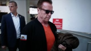 Download Arnold Schwarzenegger gets hit with donald trump questions at LAX Video