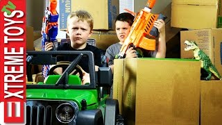 Download Nerf Gun Cardboard Box Battle! Cole Attacks Ethan with Nerf Guns for Stealing His Dinosaur Toy! Video