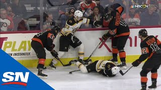Download Boston Bruins' Ryan Donato Bloodied After Hit From Behind Into Boards Video