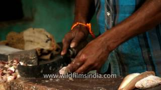 Download Local traders cut freshly caught fish at a market in Chennai Video