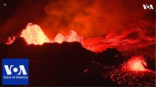 Download Lava from Hawaii's erupting Kilauea volcano lit up the night on Tuesday (May 22) Video