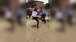 Download Police Officer Challenges Teen to Epic Dance Battle While Breaking Up Fight Video