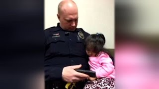 Download 2-Year-Old Girl Falls Asleep in Cop's Arms After He Offered to Babysit Video