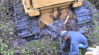 Download Caterpillar D6D stuck in mud while drum chopping Video