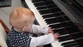 Download Amazing one year old child plays a piano concert Video