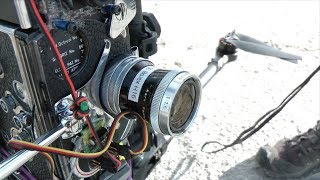 Download 16mm Bolex Film Camera on Drone and Gimbal Video