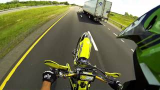 Download Biker Escapes Police While Doing Wheelies Video