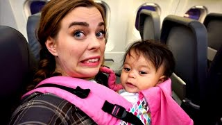 Download FLYING ALONE WITH BABY | Vlogger Fair Video