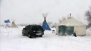 Download Dakota Access Pipeline protesters refuse to leave as snowstorm hits Video