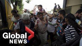 Download Migrants break through fence at Guatemala-Mexico border Video