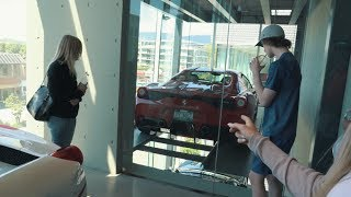 Download GLASS ELEVATOR HOLDING 4 FERRARI'S Video