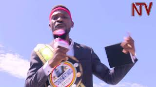 Download Drama at Entebbe Airport as police arrests Kyaddondo East MP 'Bobi Wine'. Video