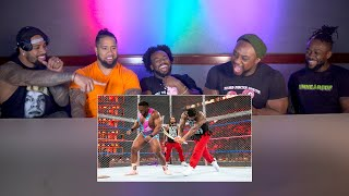 Download The Usos and The New Day watch their Hell in a Cell war: WWE Playback Video