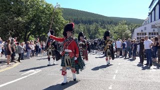 Download Ballater Games 2017 - Massed Bands Parade over River Dee & through town to highland Games Video
