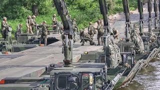 Download Troops Build Pontoon Bridge To Move Tanks Across River During NATO Drills In Lithuania Video
