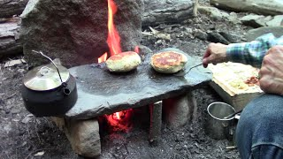 Download Primitive Cooking Stuffed Bannock On A Stone Video