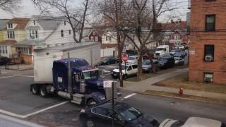 Download truck making tight turn on residental street Video