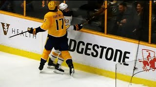 Download Antipin stretchered off after hit from Hartnell into the boards Video