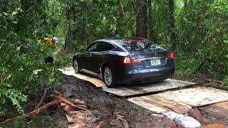 Download Tesla getting through a mud road Video