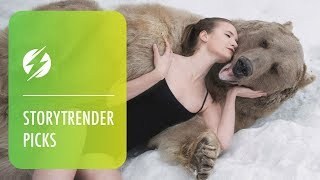 Download Russian Models Pose Next To Brown Bear Video