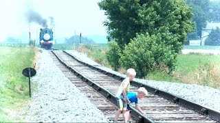 Download Children On Train Tracks While Train Is Approaching Video