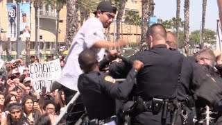 Download Anti-Trump Protesters Attack the San Diego Police at Trump Rally | Punches and Baton Melee Video
