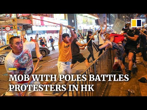 Mob with poles battles protesters in Hong Kong