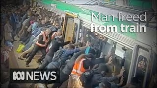 Download People power frees man trapped by Perth train Video