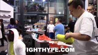 Download FLOYD MAYWEATHER CLEARS OUT SHOE STORE TO BUY NEW KICKS; SURROUNDED BY BEAUTIFUL WOMEN AND FANS Video
