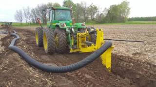 Download Laying 8″ field drain tile Video