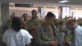 Download Watch Re-Deploying Troops Boarding Plane heading for DFW Airport Video