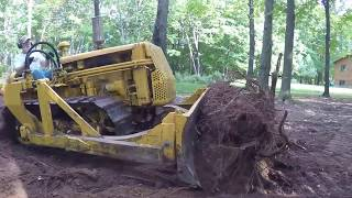Download Caterpillar D2 Bulldozing Stumps Video