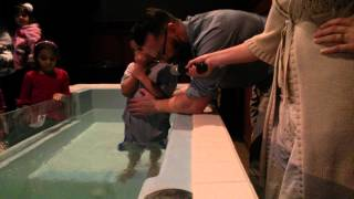 Download 3 kids and there mother getting baptized Video