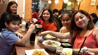 Download Punjabi and Filipino family having dinner at QQ NOODLE HOUSE at Bugis in SINGAPORE Video