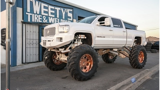Download MONSTER DENALI GETS FIFTY FOUR INCH Tires on its 24 inch Forgiato wheels with a 20 inch lift kit! Video