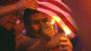 Download Donald Trump Protesters Are Burning American Flags Video