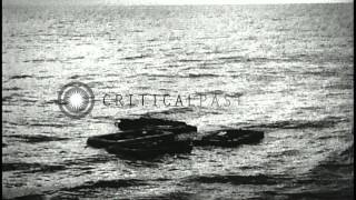 Download Survivors of USS Indianapolis floating in rubber rafts at sea and being rescued b...HD Stock Footage Video
