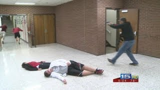 Download Middle school teachers go through shooter simulation Video