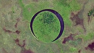 Download This Lake Is Home To A Bizarre ″Floating Eye″ Island Video