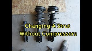 Download Learn the best way to replace a strut with and without spring compressors - Discover a better ride Video