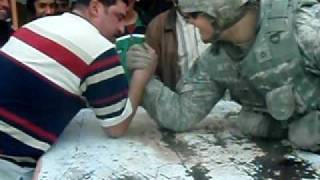 Download Army soldier embarrasses Iraqi in arm-wrestling Video