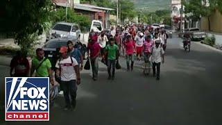 Download Trump threatens border shutdown over migrant caravan Video